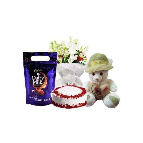 LOVE IT IS WITH FRESH FLOWER BOUQUET, CREAM CAKE, DAIRY MILK MINI BAR AND TEDDY